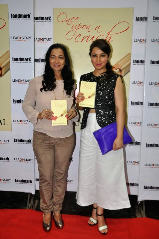 Author Kiran Manral with actor Tisca Chopra during her book launch `Once Upon a Crush` in Mumbai on May 09, 2014.