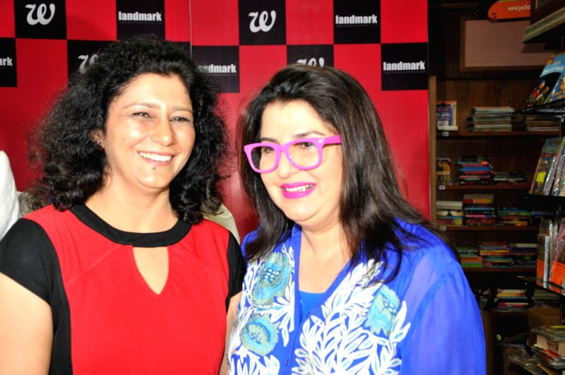 Author Sonia Golani and filmmaker Farah Khan during the launch of book Decoding Bollywood by author Sonia Golani in Mumbai, on Aug 28, 2014. - Farah Khan