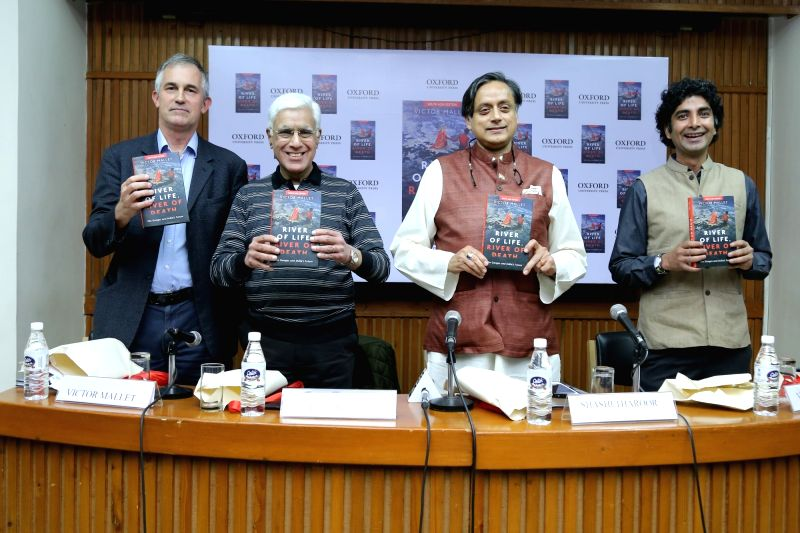 Author Victor Mallet with Lok Sabha MP Shashi Tharoor, Social Entrepreneur and Environmentalist Vimlendu Jha and journalist and Television commentator Karan Thapar during the launch of his ... - Shashi Tharoor