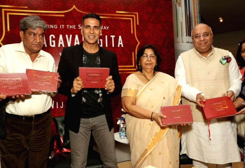 Author Vijay Singal with actor Akshay Kumar and Annurag Batra, Chairman and Editor-in-Chief, BW Businessworld at the launch of his Bhagavad Gita in New Delhi on Aug 11, 2018. - Akshay Kumar
