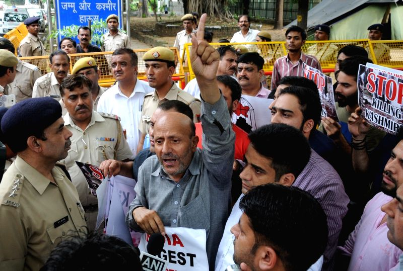 Awami Itehad Party chief and MLA Langate, Er Rashid along with his supporters stage a demonstration outside the Jammu Kashmir House at Chanakya Puri in New Delhi on July 25, 2016.
