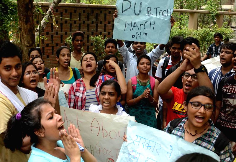 B.Tech students demonstrate against rollback of Delhi University's  four-year undergraduate programme (FYUP) in New Delhi on June 30, 2014.