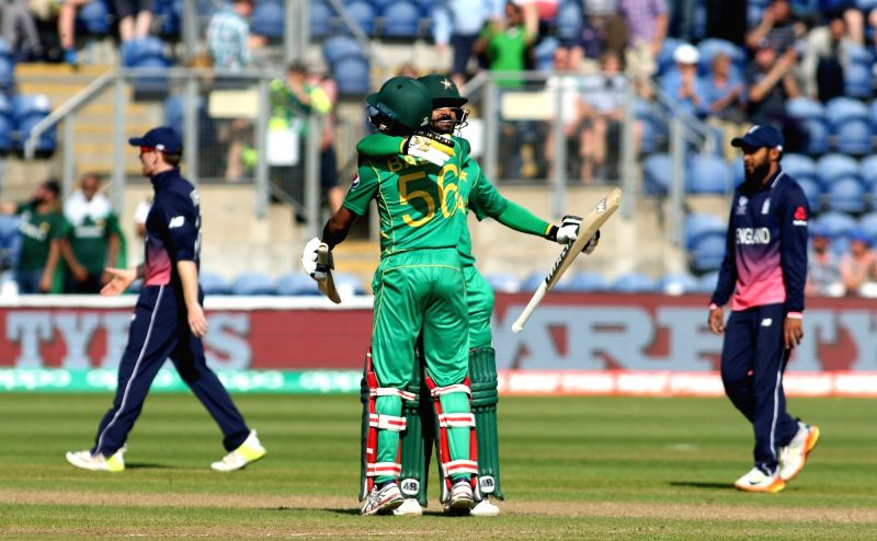 Babar Azam and Mohammad Hafeez celebrate after winning the first Semi-final match of ICC Champions Trophy between England and Pakistan at Sophia Gardens in Cardiff, Wales, Britain on June 14, 2017.