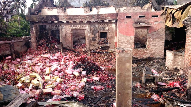 Bac Ninh: Photo taken on Dec. 15, 2014 shows the fire site in Bac Ninh province, north Vietnam, Dec. 15, 2014. The fire occurred at midnight on Dec. 14 at a shop trading votive paper, leaving three ..