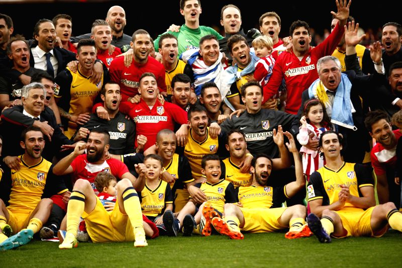 Atletico Madrid's players celebrate winning the championship after the match against Barcelona during the Spanish first division soccer match at Nou Camp stadium in