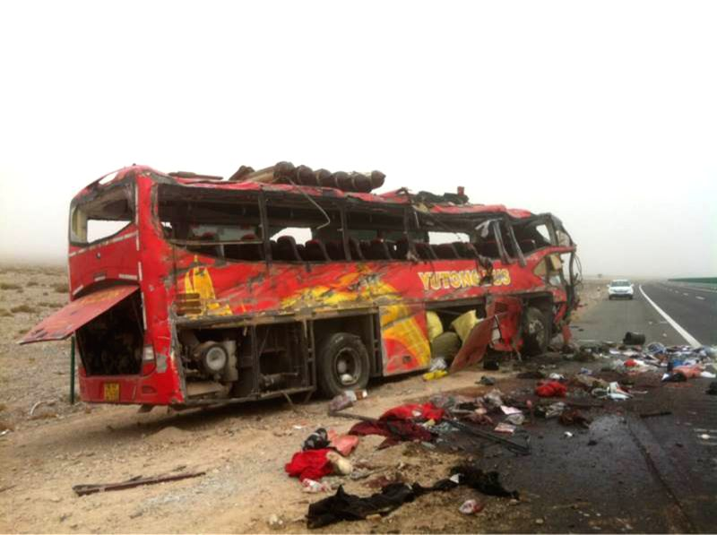 Photo taken on Feb. 25, 2015 shows the scene of a road accident site in Bachu County, Kashgar Prefecture, northwest China's Xinjiang Uygur Autonomous Region. A ...