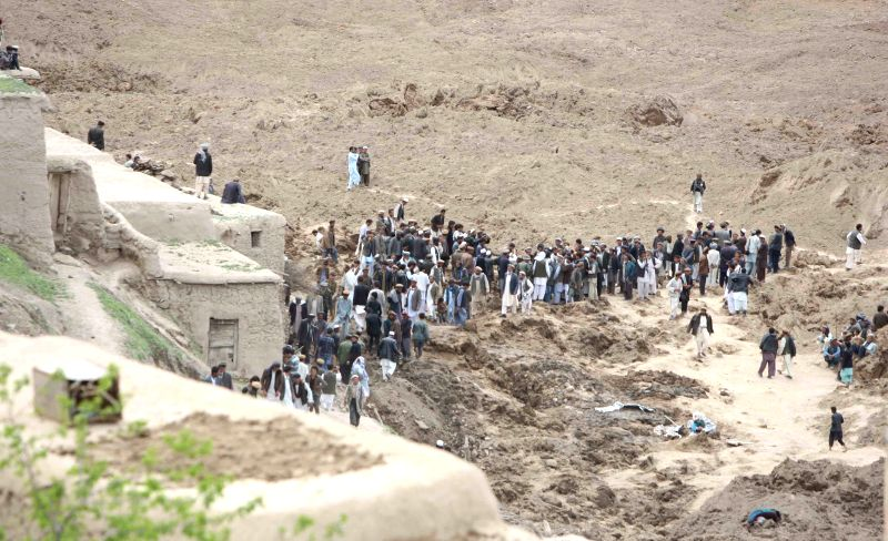 People search dead bodies of victims after a landslide in Badakhshan, Afghanistan, May 3, 2014. A massive landslide hit a village in northern Afghan Badakhshan ...