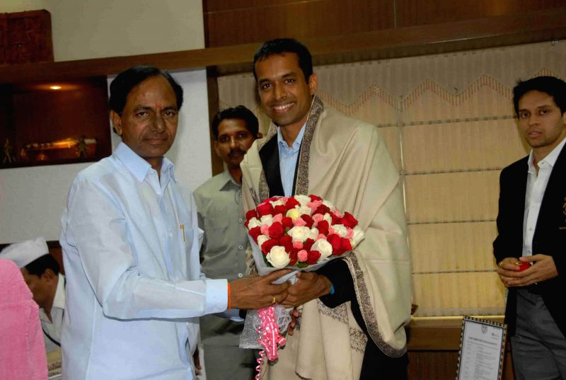 Badminton coach Pullela Gopichand with Telangana Chief Minister K Chandrasekhar Rao during a meeting in Hyderabad on Aug 6, 2014. - K Chandrasekhar Rao
