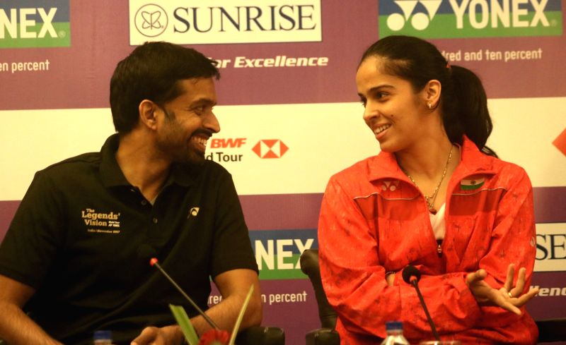 Badminton star Saina Nehwal with national coach Pullela Gopichand during a press conference to launch Yonex- Sunrise Dr. Akhilesh Das Gupta India Open 2018 in New Delhi on Jan. 30, 2018.