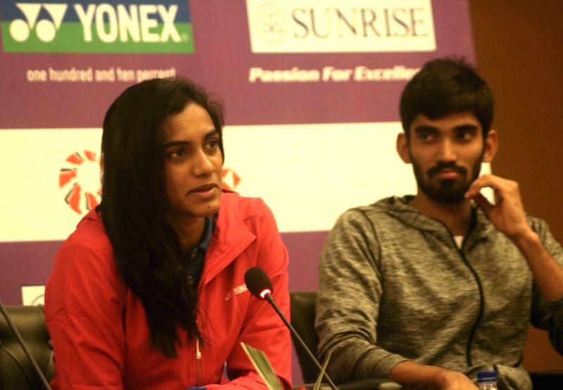 Badminton stars PV Sindhu with Kidambi Srikanth during a press conference to launch Yonex- Sunrise Dr. Akhilesh Das Gupta India Open 2018 in New Delhi on Jan. 30, 2018.