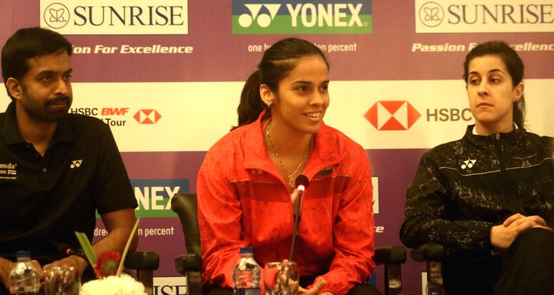 Badminton stars Saina Nehwal, Carolina Marin of Spain with Indian coach Pullela Gopichand during a press conference to launch Yonex- Sunrise Dr. Akhilesh Das Gupta India Open 2018 in New ...