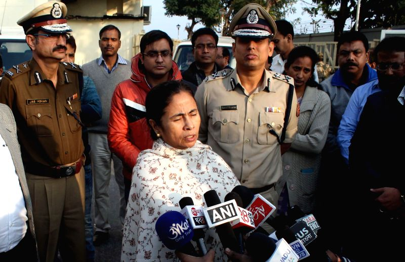 West Bengal Chief Minister Mamata Banerjee talks to press at Bagdogra Airport on Dec 26, 2014. - Mamata Banerjee