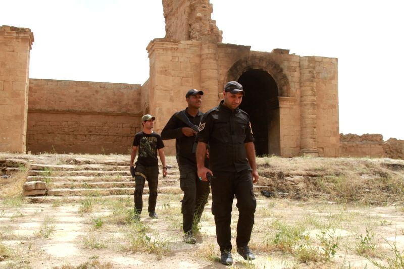 BAGHDAD, April 28, 2017 - Iraqi paramilitary soldiers patrol at the ancient Hatra city in the south of Nineveh province, Iraq, on April 28, 2017. Iraqi paramilitary units, known as Hashd Shaabi, on ...