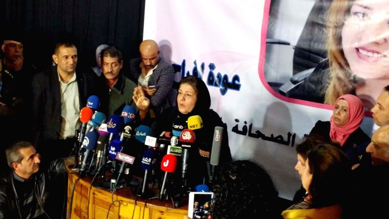 BAGHDAD, Jan. 4, 2017 - Iraqi female journalist Afrah Shawqi (C) holds a press conference after she was released by captors in Baghdad, Iraq, on Jan. 4, 2017. The Iraqi female journalist and activist ...
