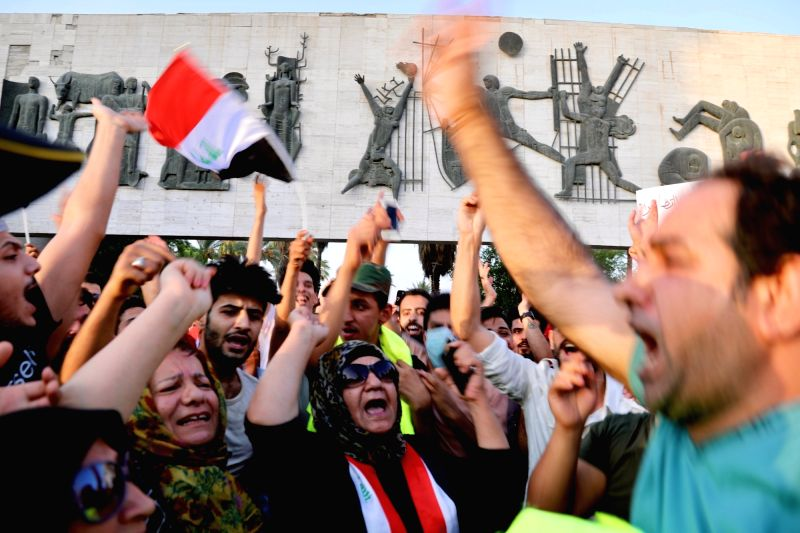 BAGHDAD, July 27, 2018 - Protesters gather at the Tahrir Square in Baghdad, Iraq, on July 27, 2018. Iraqi protesters took to the streets Friday in Baghdad and other parts of the country, demanding ...