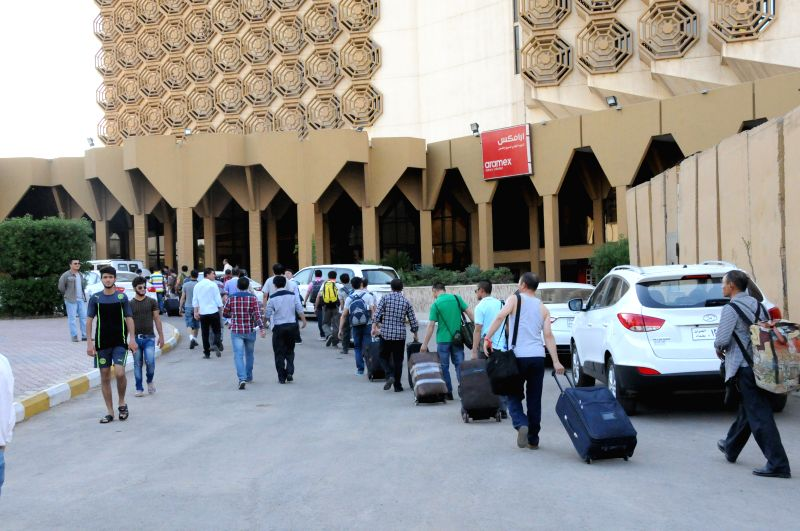 Chinese workers arrive at a hotel in Baghdad, Iraq, on June 28, 2014. All of the more than 1,200 Chinese workers trapped in the northern Iraqi city of Samarra have .