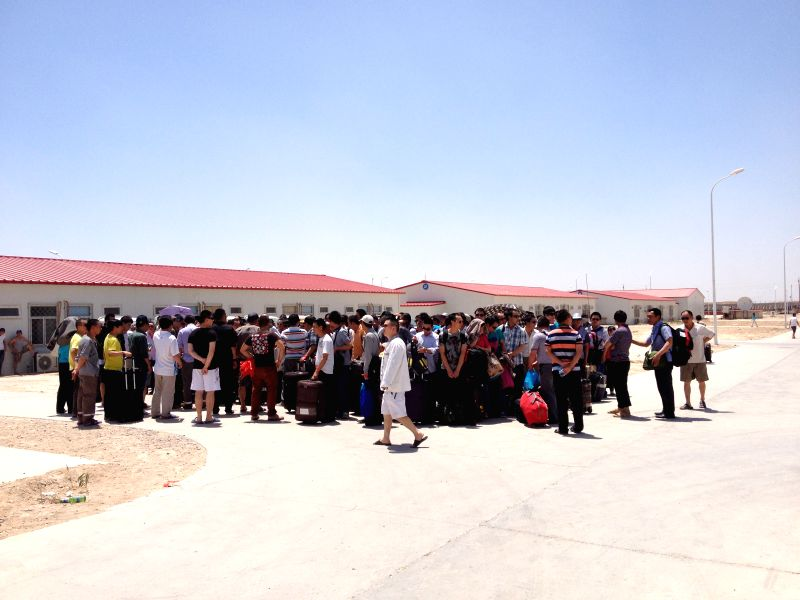 Chinese workers wait for evacuation in  Samarra, capital of the Salahudin province, Iraq, on June 26, 2014. All of the more than 1,200 Chinese workers trapped in ...