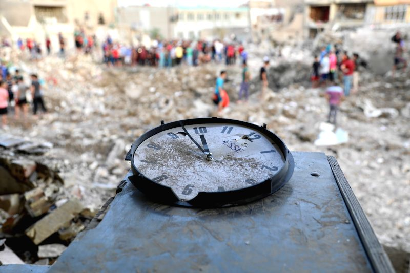 BAGHDAD, June 7, 2018 - A clock destroyed in a huge explosion suggests the time of the explosion in eastern Baghdad, Iraq, June 7, 2018. The death toll of a huge explosion in eastern Baghdad on ...
