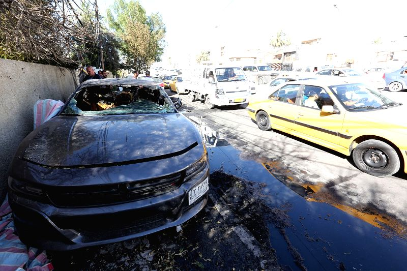 BAGHDAD, May 14, 2017 - A damaged car is seen at the site of a suicide bomb attack in Karrada district, Baghdad, capital of Iraq, on May 14, 2017. A suicide car bomb exploded at a police checkpoint ...