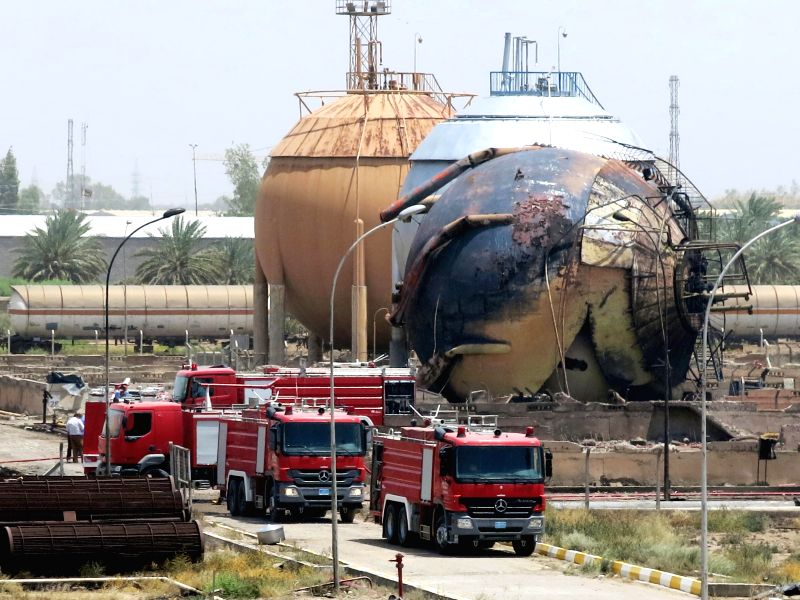 BAGHDAD, May 15, 2016 - Fire engines are seen at a gas plant after it was attacked by Islamic State (IS) suicide bombers, in Taji area, northern suburb of the Iraqi capital of Baghdad, May 15, 2016. ...