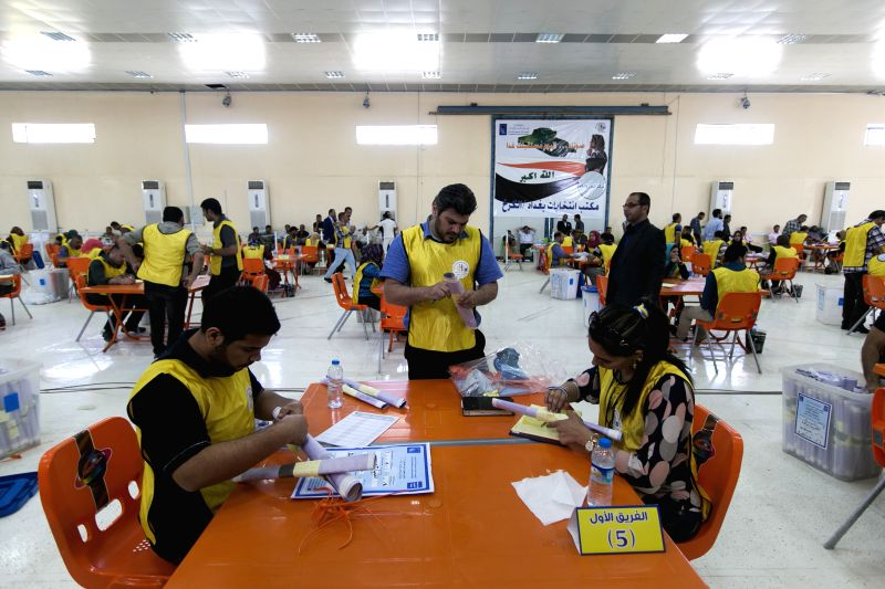 Working staffs are seen counting the ballots in an election counting center in Baghdad, May 2, 2014. The counting for Iraq's parliamentary election started here on ...
