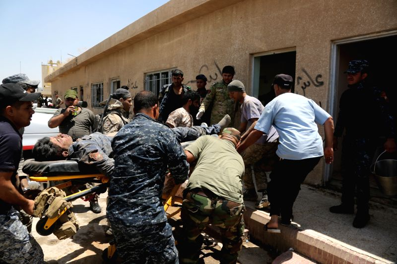 BAGHDAD, May 25, 2016 - A soldier who was wounded during battles against Islamic States militants is sent to a field hospital for rescue on the outskirts of Fallujah in Iraq's western Anbar province, ...