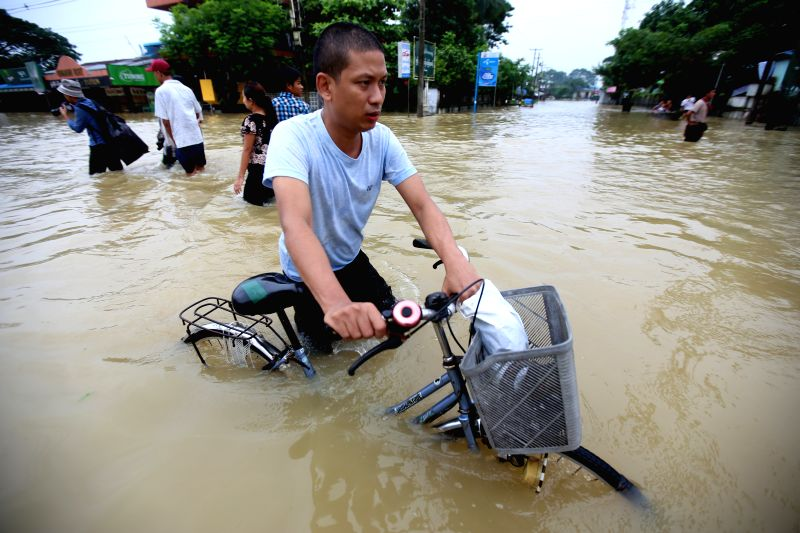 BAGO, July 28, 2018 - A resident wades through flood water in Bago Region, Myanmar, July 28, 2018. People in Bago Region are being affected by flood due to the continuous heavy rainfall.