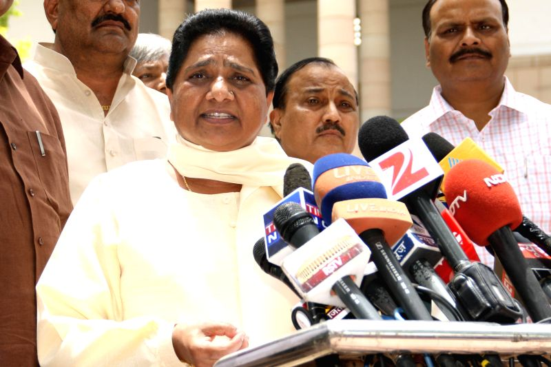 Bahujan Samaj Party (BSP) chief Mayawati talks to media regarding rail budget 2014-15 which was presented in the Parliament by Union Railway Minister D.V. Sadananda Gowda, at Parliament premises in .. - D.