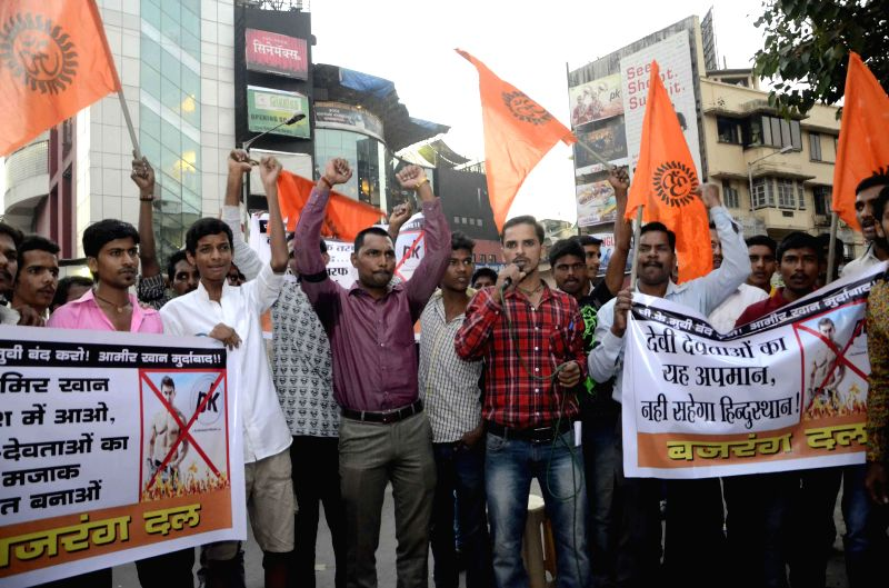 Bajrang Dal workers demonstrate against Amir Khan starrer `PK` outside a Mumbai theater in Mumbai, on Dec 28, 2014. - Khan