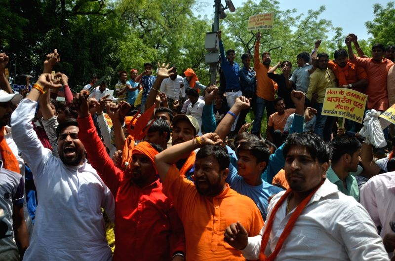 "Bajrang Dal workers stage a protest against Pakistan after an Army soldier and a BSF trooper were killed and ""mutilated"" on the LoC in Jammu and Kashmir by Pakistani forces; at ..."