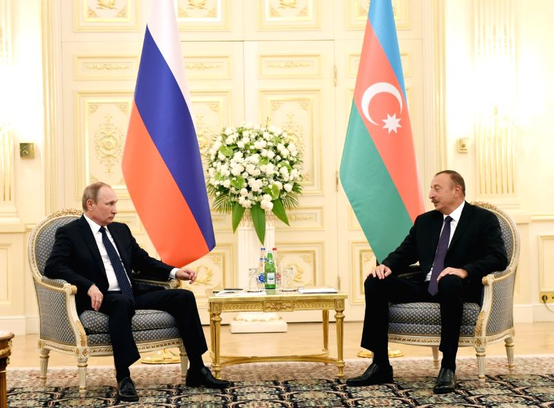 BAKU, Aug. 8, 2016 - Russian President Vladimir Putin (L) meets with Azerbaijani President Ilham Aliyev in Baku, Azerbaijan, on Aug. 8, 2016. Putin arrived here on Monday for a trilateral meeting ... - Hassan Rouhani