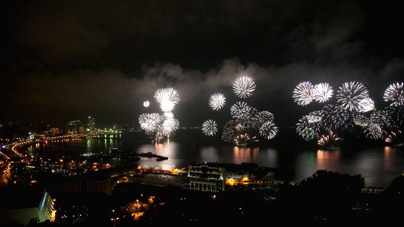 Fireworks light up the sky above the Caspian Sea in Baku, Azerbaijan on Jan 1, 2015.