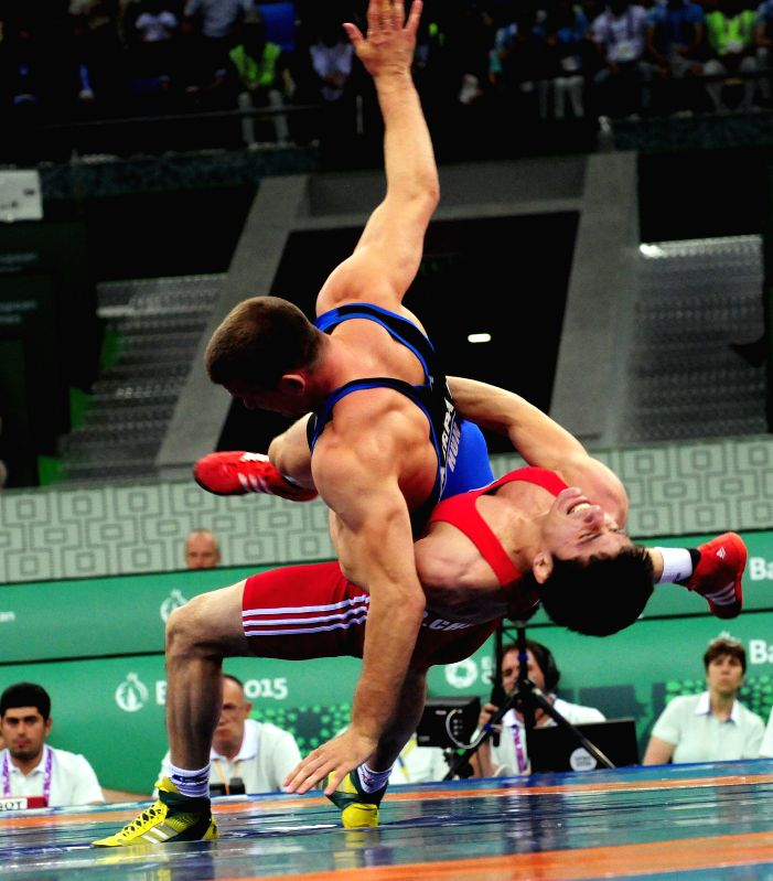 Ruslan Chunayev (Bottom) from Azerbaijan competes with Balint Korpasi from Hungary during the final of the men's 71kg Greco-Roman style wrestling at the European Games ...