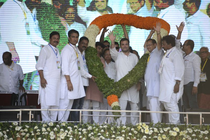 Balasore: Congress President Rahul Gandhi being welcomed by party workers during a public rally in Odisha's Balasore, on April 26, 2019.