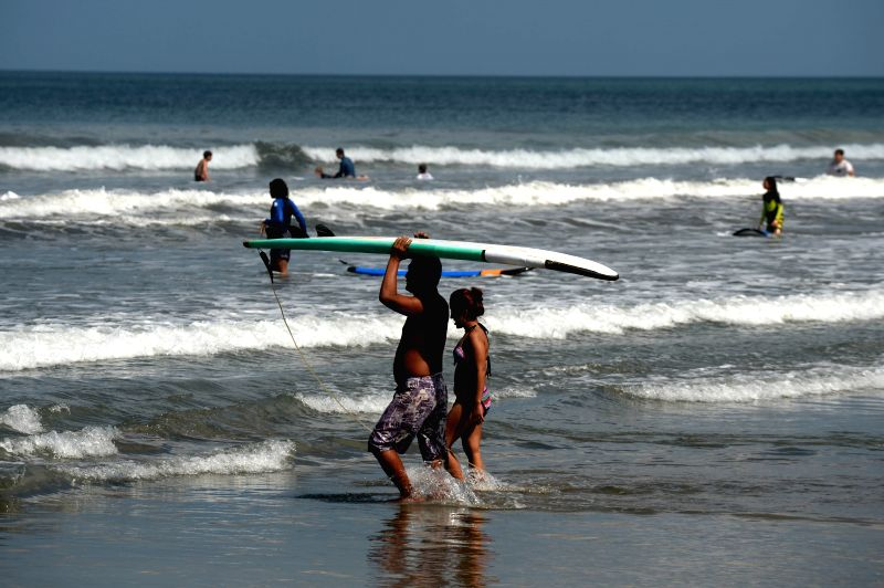 BALI, Sept. 29, 2017 - Tourists enjoy themselves at a beach in Kuta of Bali, Indonesia, Sept. 29, 2017.