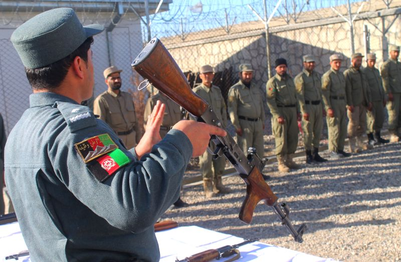 Afghan local policemen take part in their training at a local police center in Balkh province, Afghanistan, on Dec. 15, 2014.