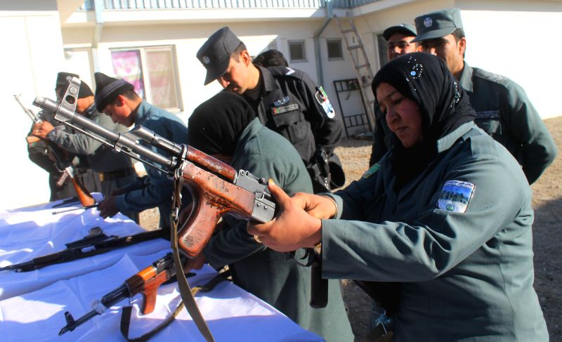 Afghan local policewomen take part in their training at a local police center in Balkh province, Afghanistan, on Dec. 15, 2014.