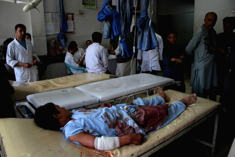 BALKH, Aug. 8, 2018 - An injured man receives medical treatment at a local hospital in Mazar-i-Sharif, capital of Balkh province, Afghanistan, Aug. 8, 2018. Six civilians were killed and seven others ...