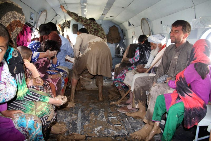 Victims sit in a helicopter to be transferred from flooded area in Balkh province in northern Afghanistan on May 12, 2014.