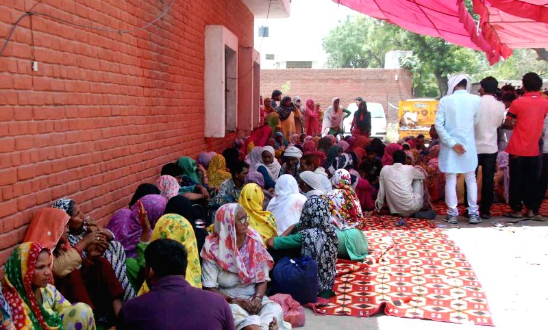 People take refuge in a Police Station after communal riots broke out in Ballabhgarh of Haryana on May 29, 2015.