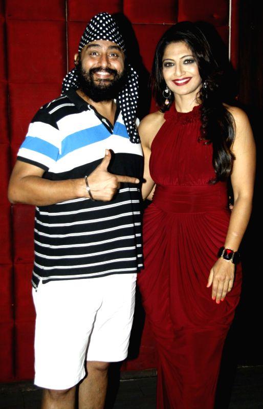Ballu and writer Aarti Nagpal during the party to celebrate Aarti winning Dadasaheb Phalke Award in Mumbai on July 26, 2016.