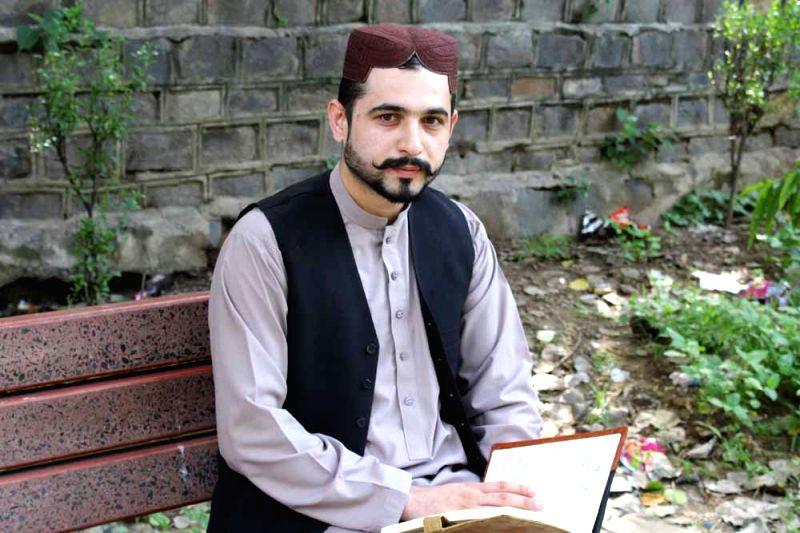 "Baloch freedom movement activist Mazdak Dilshad Baloch in a park of New Delhi\""."