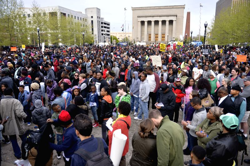 Hundreds of demonstrators hold a rally and march to protest against police brutality and the death of Freddie Gray, in front of the City Hall of Baltimore, ...