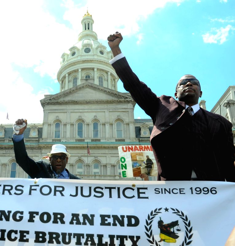Two men shout slogans at a rally in front of the City Hall in Baltimore, Maryland, the United States, May 2, 2015. Thousands of people in Baltimore, the largest ...