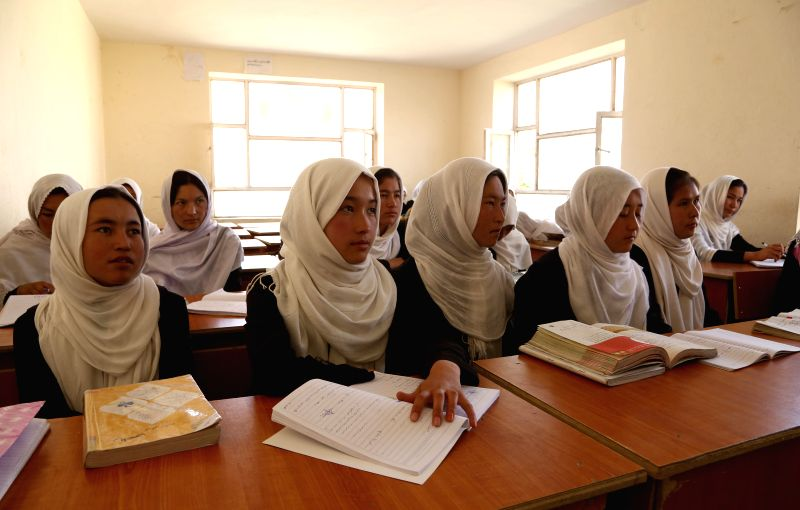 Afghan female students attend a class in a school in Bamyan province, central Afghanistan, on Aug. 17, 2014.