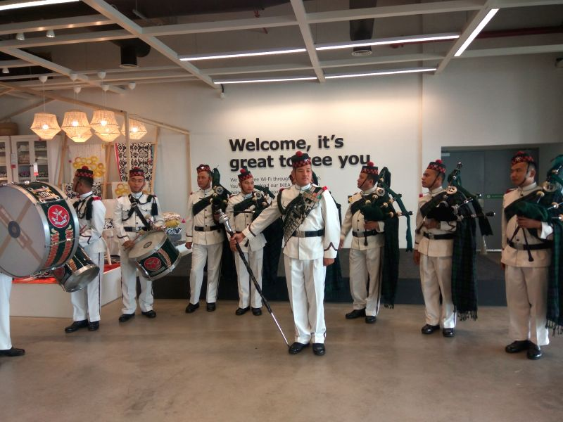 Band welcoming shoppers.