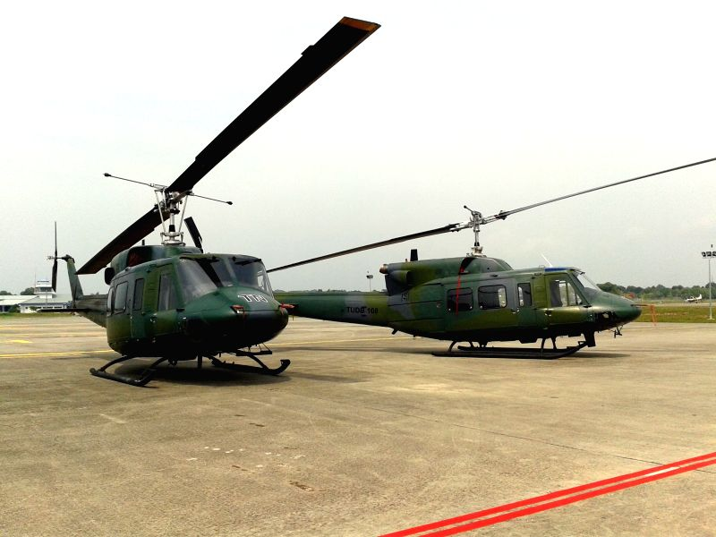 "Two BELL helicopters are displayed at Rimba Air Force Base in Bandar Seri Begawan, Brunei, Aug. 1, 2014. ""It was a sad yet honour moment, having to . - Walee"