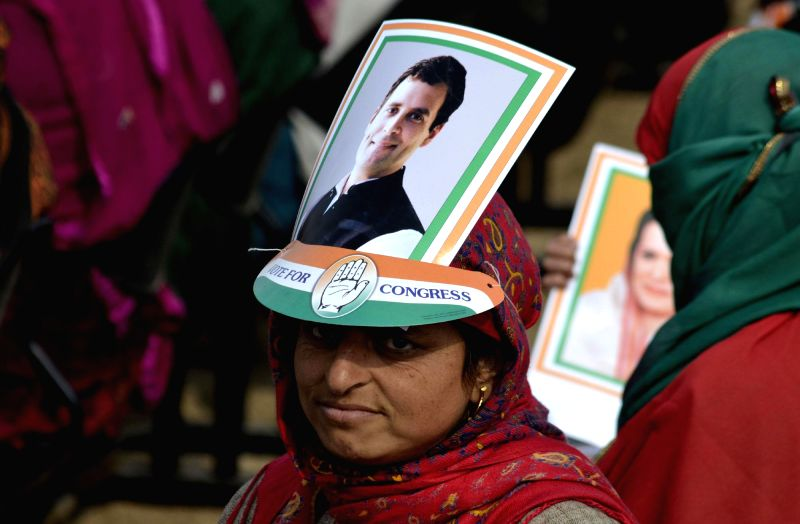 A lady wears a headgear with the picture of Congress vice president Rahul Gandhi during a Congress rally in Bandipora of Jammu and Kashmir on Nov 21, 2014. - Rahul Gandhi