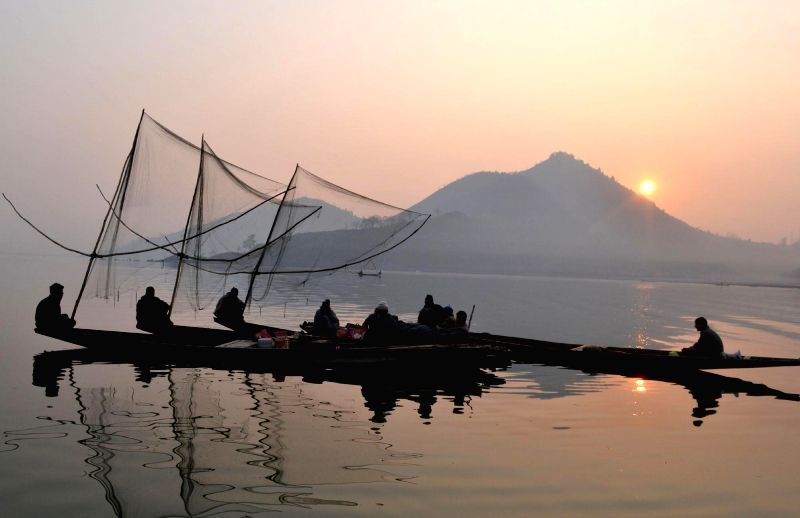 Fishermen cast their nets in Wular Lake - one of the largest fresh water lakes in Asia - in Bandipora district of Jammu and Kashmir on Jan 1, 2015.