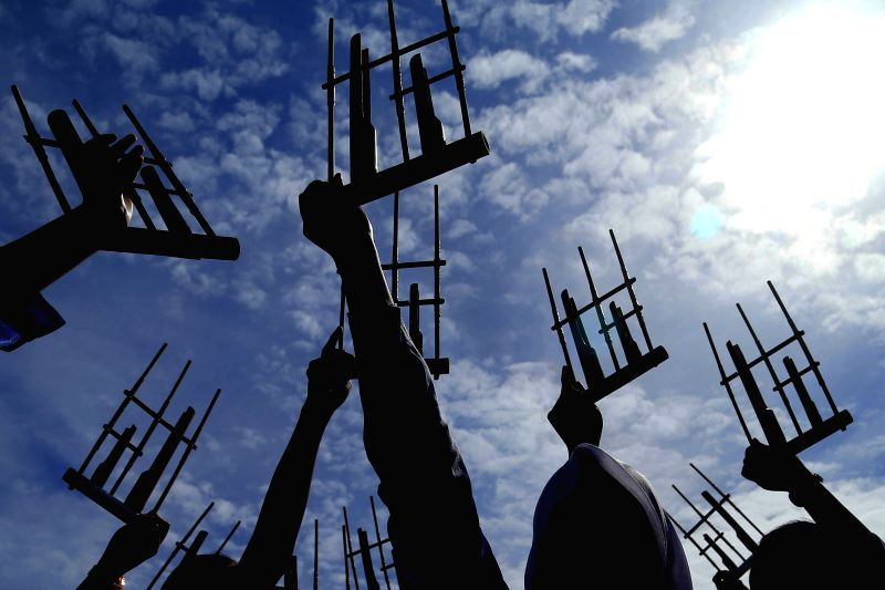 People play angklung, an Indonesian traditional musical instrument, during the commemoration of Asian-African Conference in Bandung, Indonesia, on April 23, 2015. ...